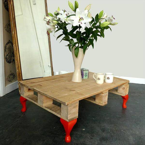 rustic whole pallet coffee table with short orange legs