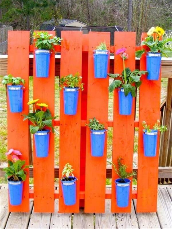 orange painted pallet vertical herb garden