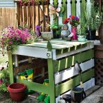 white and green pallet potting bench